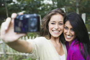 Friends taking a selfie. Purestock/Getty Images