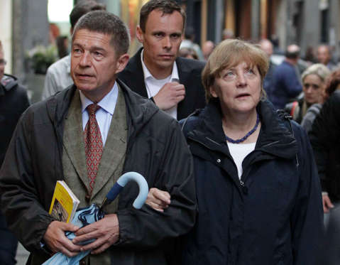 German Chancellor Angela Merkel (R) and her husband Joachim Sauer walk during their Easter holiday in downtown Naples, southern Italy April 19, 2014.