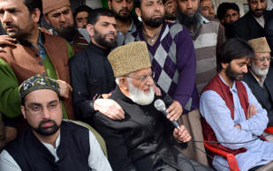 File: Budgam: The chairman of the Hurriyat's moderate faction Mirwaiz Umar Farooq, Hardline Hurriyat leader Syed Ali Shah Geelani and  Jammu Kashmir Liberation Front (JKLF) chief Yasin Malik and others during a condolence meet in Narbal village of Jammu and Kashmir's Budgam district where a teenager was killed recently, on April 20, 2015.