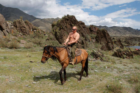 FILE - This Aug. 3, 2009 file-pool photo shows then-Russian Prime Minister Vladimir Putin riding a horse while traveling in the mountains of the Siberian Tyva region of Russia, during his vacation. Former Arkansas Gov. Mike Huckabee says the US standing in the world has diminished under President Barack Obama and its next leader faces a tough task in rebuilding America's might. Speaking before the annual gathering of conservative, Huckabee said that as a result, Russian President Vladimir Putin only shakes when he takes his shirt off in the Russian winter but not when Washington threatens him.