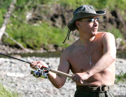 Russia's President Vladimir Putin fishes in the Yenisei River in Siberia as he makes a tour together with Prince Albert II of Monaco in this August 13, 2007 file photo. Time magazine named Putin its