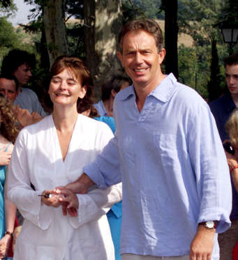 British Prime Minister Tony Blair (R) enjoys a walk with his wife Cherie outside their vacation residence in Saint-Martin d'Oydes, southwestern France, August 26, 2001.