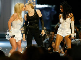 Britney Spears (L) gets a kiss on the mouth from Madonna as Christina Aguilera (R) looks on during the opening of the 2003 MTV Video Music Awards at the Radio City Music Hall in New York, August 28, 2003.