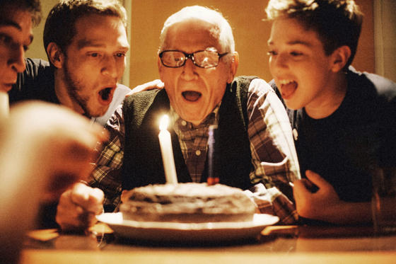 Slide 1 of 16: Young men celebrating their grandfather's birthday