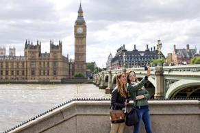 Two women stand by a wall on the bank of the River Thames as they pose for a 'selfie' photograph opposite the Elizabeth Tower, home to Big Ben, and the Houses of Parliament in central London on June 6, 2015. Justin Tallis/AFP/Getty Images