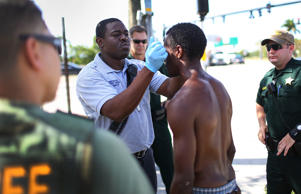 A Broward County Fire Rescue paramedic takes the temperature of man who was suspected of being under the influence of the drug Flakka as Broward Sheriff's Office Sergeant Ozzy Tianga (L), along with other Deputies, stand by in case the man became violent on June 17, 2015 in Pompano Beach, Florida.  The Sheriff's Office is on the front lines to keep people from the drug, categorized as a bath salts, which has become an epidemic among users because the cheap synthetic drug made in overseas pharmaceutical plants can be swallowed in capsule form, snorted, injected, or smoked via an e-cigarette. Some of the effects of the drug include body overheating, a heightened sense of euphoria and greater propensity for uncontrollable violence.