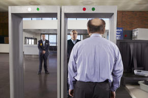 Man going through airport security.