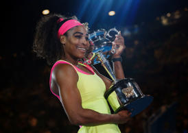 Serena Williams of the U.S. poses with her trophy after defeating Maria Sharapova of Russia in their women's singles final match at the Australian Open 2015 tennis tournament in Melbourne January 31, 2015. REUTERS/Issei Kato (AUSTRALIA - Tags: SPORT TENNIS)
