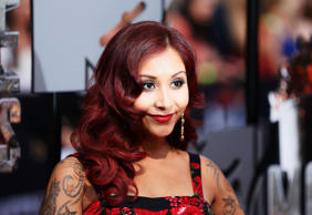 Snooki arrives at the 2014 MTV Movie Awards in Los Angeles, California April 13, 2014.