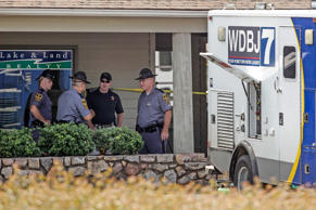 Police work the crime scene at Bridgewater Plaza on Smith Mountain Lake on August 26, 2015 in Moneta, Virginia. Two employees of WDBJ TV were killed this morning during a live broadcast. The victims have been identified as reporter Alison Parker and camerman Adam Ward. Parker, 24 and Ward, 27, worked for WDBJ in Roanoke, Virginia. The suspect, Vester Lee Flanigan, also known as Bryce Williams, died of a self-inflicted gunshot wound.