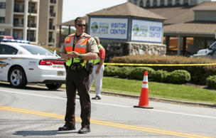 A law enforcement officer is seen on the road in front of the Bridgewater Plaza ...