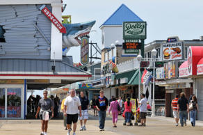In this photo taken Tuesday, May 16, 2012, visitors enjoy the boardwalk in Ocean City, Md.