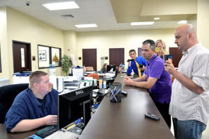 William Smith Jr., right, and his partner James Yates, second right, speak with an unnamed clerk in an attempt to obtain a marriage license at the Rowan County Courthouse in Morehead, Ky., Thursday, Aug. 27, 2015. The couple were denied a marriage license despite the ruling of the 6th U.S. Circuit Court of Appeals upholding an earlier decision instructing the clerks to issue mariage licenses. This was the couple's third attempt to obtain a marriage license.