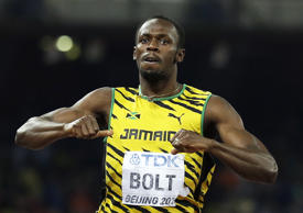 Jamaica's Usain Bolt celebrates after winning the men's 200m final at the World Athletics Championships at the Bird's Nest stadium in Beijing, Thursday, Aug. 27, 2015.