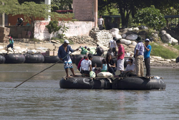 People are transported to the Guatemalan shore across the broad Suchiate river that separates, Tecun Uman, Guatemala and Ciudad Hidalgo, Mexico, on July 11, 2014.