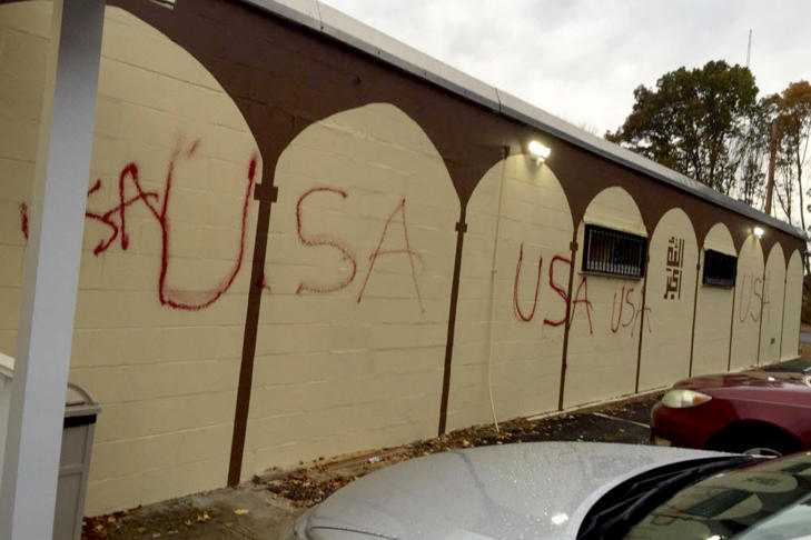 <p>Graffiti vandalism spray-painted on the side of the Islamic Center of Burlington in Burlington, Mass.</p>