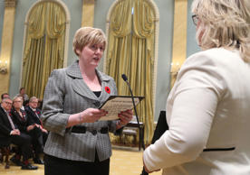 Canada's new Sport, and Persons with Disabilities Minister Carla Qualtrough is sworn-in during a ceremony at Rideau Hall in Ottawa November 4, 2015.