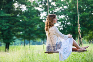 Young Beautiful Woman On A Swing.