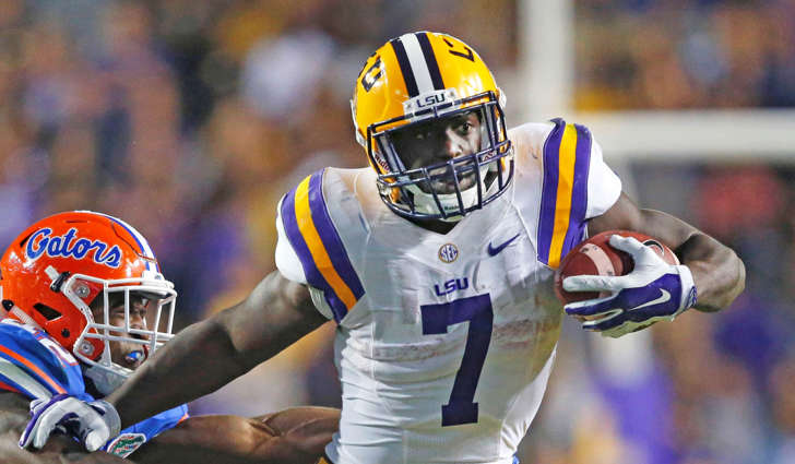 LSU running back Leonard Fournette (7) carries against Florida defensive back Keanu Neal (42) in the second half of an NCAA college football game in Baton Rouge, La., Saturday, Oct. 17, 2015.