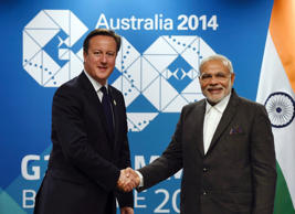 File: British Prime Minister David Cameron (L) meets with Indian Prime Minister Narendra Modi at their bilateral meeting before the G20 leaders Summit in Brisbane, November 14, 2014.