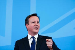 File: Britain's Prime Minister David Cameron speaks on the economy to an audience at a school in Poole, southern England, December 15, 2014.