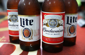 In this photo illustration, bottles of Budweiser and Miller Lite beer are seen on Sept. 16, 2015 in Miami.