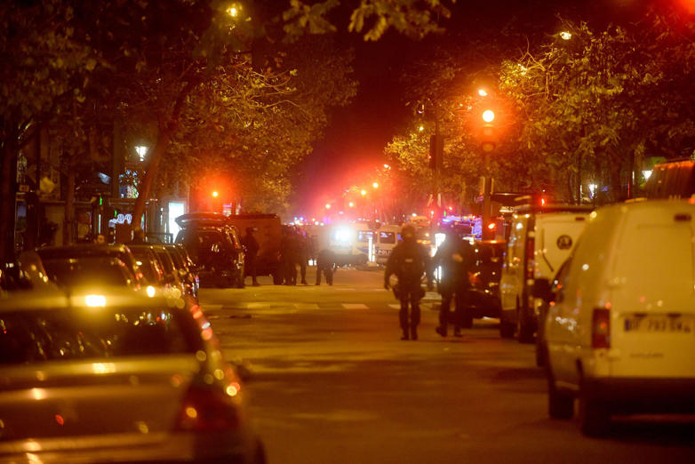Policemen patrol the streets during gunfire near the Bataclan concert hall
