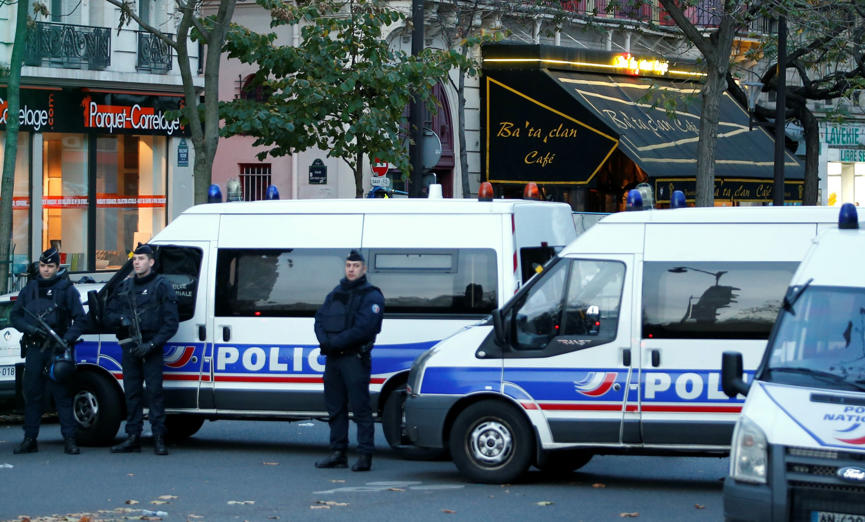 Police vehicles block the street in front of the Bataclan concert hall the morning after a series of deadly attacks in Paris , November 14, 2015. Charles Platiau/Reuters
