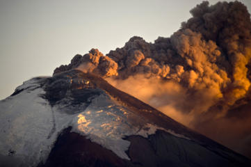 View of the Cotopaxi volcano spewing ashes from Sangolqui, Ecuador on August 23, 2015. A dozen towns of central Ecuador, including Quito sector, suffered Saturday the ashes of the Cotopaxi volcano, which started erupting a week ago after 138 years, as crops and cattle were affected. AFP PHOTO / Martin Bernetti        (Photo credit should read MARTIN BERNETTI/AFP/Getty Images)