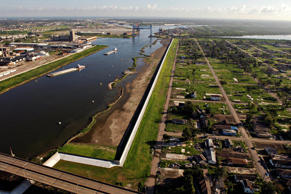 A repaired levee wall runs between the Industrial Canal and a barron portion of the Lower Ninth Ward, the site where a large barge broke through the levee during Hurricane Katrina in New Orleans, Louisiana. Daniel Acker/Bloomberg News