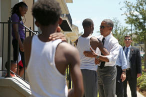 President Barack Obama greets residents in the the Tremé neighborhood in New Orleans, Thursday, Aug. 27, 2015, for the 10th anniversary since the devastation of Hurricane Katrina. Tremé is one of the oldest black neighborhoods in America, which borders the French Quarter just north of Downtown.