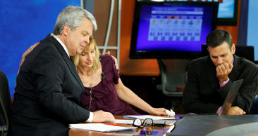 WDBJ-TV7 news morning anchor Kimberly McBroom, center, gets a hug from visiting anchor Steve Grant, left, as meteorologist Leo Hirsbrunner reflects after their early morning newscast at the station, Thursday, Aug. 27, 2015, in Roanoke, Va. Reporter Alison Parker and cameraman Adam Ward were killed during a live broadcast Wednesday, while on assignment in Moneta.
