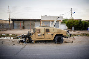 Destroyed during heavy clashes with ISIS militants a humvee belonging to the Iraqi military lays along the streets of Kirkuk. In the last week ISIS militants have gained controlled of a large area in Iraq and are moving towards the capital of Baghadad. June 13, 2014.
