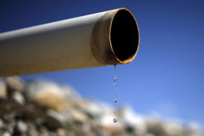 A dry pipe drips water on Gless Ranch in Kern County, California, July 23, 2015.