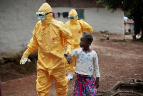 In this Sept. 30, 2014 file photo, a child is taken to an ambulance after showing signs of the Ebola virus disease in Liberia.