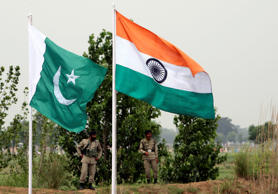 File: Pakistani rangers stand near the Indian (R) and Pakistani national flags during an annual fair near Pakistan border in Chamliyal, 45 km (28 miles) west of Jammu, June 26, 2008.