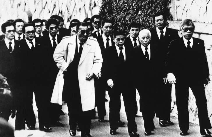 Top members of the Yamaguchi-gumi, Japan's largest Yakuza organization, arrive for the funeral for their boss Masahisa Takenaka in Kobe, western Japan, Dec. 15, 1988.