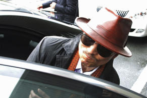 "Kenichi Shinoda, the boss of Japan's largest ""yakuza"" gang, the Yamaguchi-gumi, gets into a car after arriving at the train station in Kobe, western Japan on April 9, 2011 after he was released from a Tokyo prison after serving time since 2005."