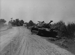 File: A disabled Pakistani tank lying by the roadside in the Bahara sector during the India-Pakistan conflict.