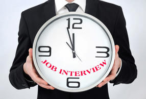 Business man holding clock with job interview