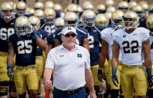 Notre Dame Fighting Irish head coach Brian Kelly leads his players into the LaBar Practice Complex for the Blue-Gold Game on April 18, 2015, in South Bend, Ind.