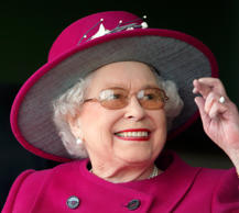 NEWBURY, UNITED KINGDOM - APRIL 17: (EMBARGOED FOR PUBLICATION IN UK NEWSPAPERS UNTIL 48 HOURS AFTER CREATE DATE AND TIME) Queen Elizabeth II crosses her fingers as she watches her horse 'Ring of Truth' run in the Al Basti Equiworld EBF Stallions Maiden Stakes during the Dubai Duty Free Spring Trials Meeting at Newbury Racecourse on April 17, 2015 in Newbury, England.