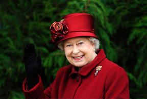 Britain's Queen Elizabeth II waves as she arrives for the final day of the Cheltenham Festival horse racing meeting in Gloucestershire, western England March 13, 2009.