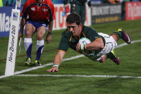South Africa's Morne Steyn dives across the line to score a try during their Rugby World Cup game at North Harbour Stadium in Auckland, New Zealand, Thursday, Sept. 22, 2011. (AP Photo/Dita Alangkara)