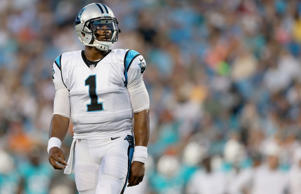 Cam Newton of the Carolina Panthers looks on during a pre-season game against the Miami Dolphins at Bank of America Stadium on Aug. 22, 2015 in Charlotte, N.C.