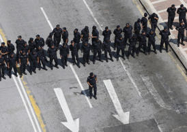 "Police block a road ahead of a protest organised by pro-democracy group ""Bersih""..."