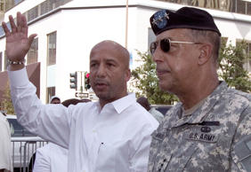 New Orleans Mayor Ray Nagin, left, waves as he is guided through a procession entitled the 'Afternoon Funeral Jazz Requiem' by military officer General Honore in New Orleans, Louisiana on Tuesday, August 29, 2006.