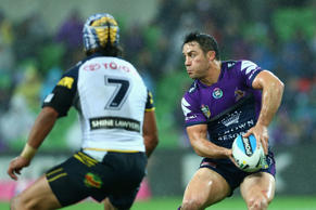 Cooper Cronk of the Storm prepares to offload the ball during the round 25 NRL match