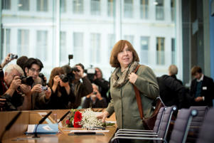 Belarussian journalist and writer Svetlana Alexievich receives flowers at a press conference two days after winning the 2015 Nobel Prize in Literature on October 10, 2015 in Berlin, Germany.