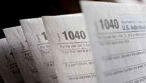 U.S. Department of the Treasury Internal Revenue Service (IRS) 1040 Individual Income Tax forms for the 2014 tax year are arranged for a photograph in Tiskilwa, Illinois, U.S., on Monday, March 16, 2015. The deadline for filing 2014 U.S. income taxes is Wednesday, April 15, 2015.